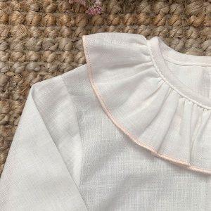 Blusa crudo con ribete rosa